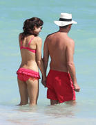 Olga Kurylenko - wearing a bikini at a Miami beach 10/16/12