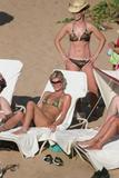 http://img15.imagevenue.com/loc386/th_38316_ParisHilton_Beach02_123_386lo.jpg