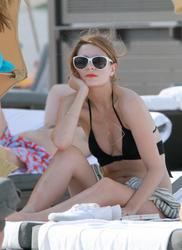http://img15.imagevenue.com/loc60/th_311331396_KVH8TY70XZ_Mischa_Barton_Wearing_a_Bikini_in_Miami015_122_60lo.jpg