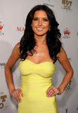 Audrina Patridge shows cleavage in strapless body-hugging yellow dress at Maxim's 2008 Hot 100 Party in Los Angeles