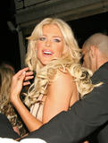 Victoria Silvstedt shows big cleavage at the Dolce nightclub in London
